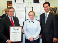 State Rep. Bill Straus, D-Mattapoisett, presents CPAP Cadet 2nd Lt. Heidi Schneider of Mattapoisett with the Billy Mitchell Award in Plymouth last month. State Rep. Vinny deMachedo, R-Plymouth, is to the right.