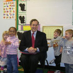 Bill reading to pre-school students in Middleboro